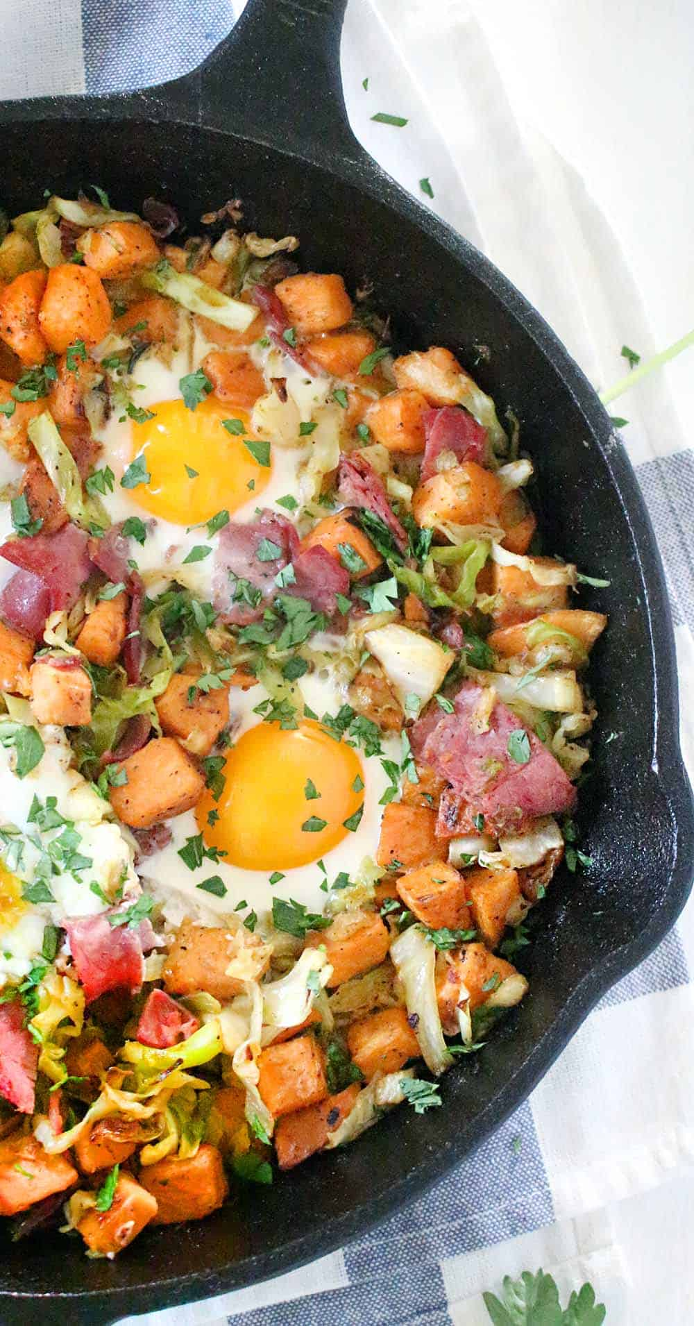 This four ingredient Sweet Potato, Corned Beef, and Cabbage Breakfast Bake is low-carb, gluten-free, and paleo friendly! Start your day with this delicious, nutrient-packed recipe.