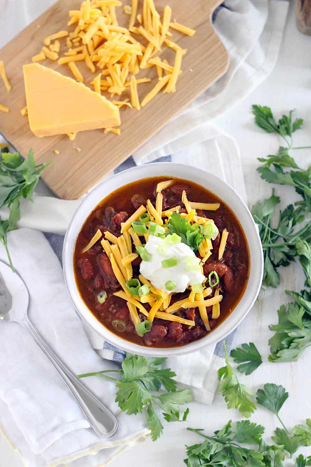 This Instant Pot Chili is made with ground beef and dry kidney beans, and comes together in less than an hour! It's cheap, healthy, and DELICIOUS.