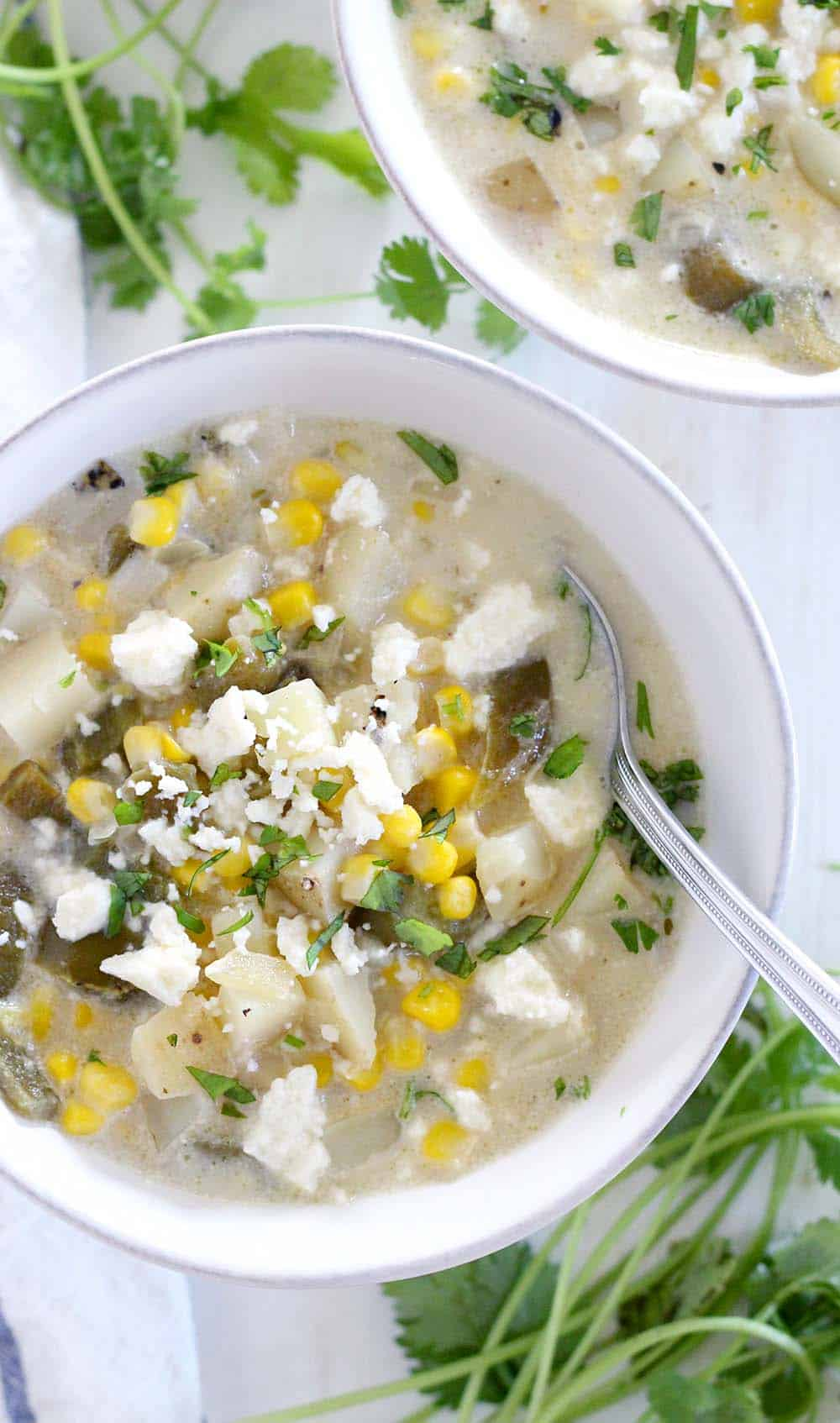This mild green chile and corn chowder is thick and creamy, packed with sweet corn and mild fire-roasted green chiles. It's a gluten-free, vegetarian, hearty soup perfect for the end of summer!