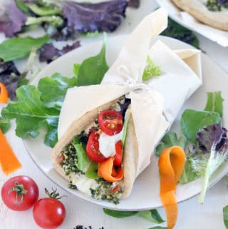 These are the ULTIMATE vegetarian pita sandwiches (vegan optional), piled high with hummus, tabbouleh, dill yogurt sauce, pickled veggies, greens, and tomatoes. Make in advance for lunch all week! #mealprep #vegetarian #sandwiches