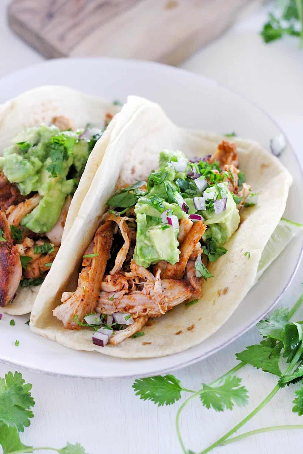 These smoky chicken and avocado tacos come together in only 20 minutes! They'll be your new favorite easy weeknight recipe for taco night and the whole family will love them. #TacoTuesday #MexicanFood