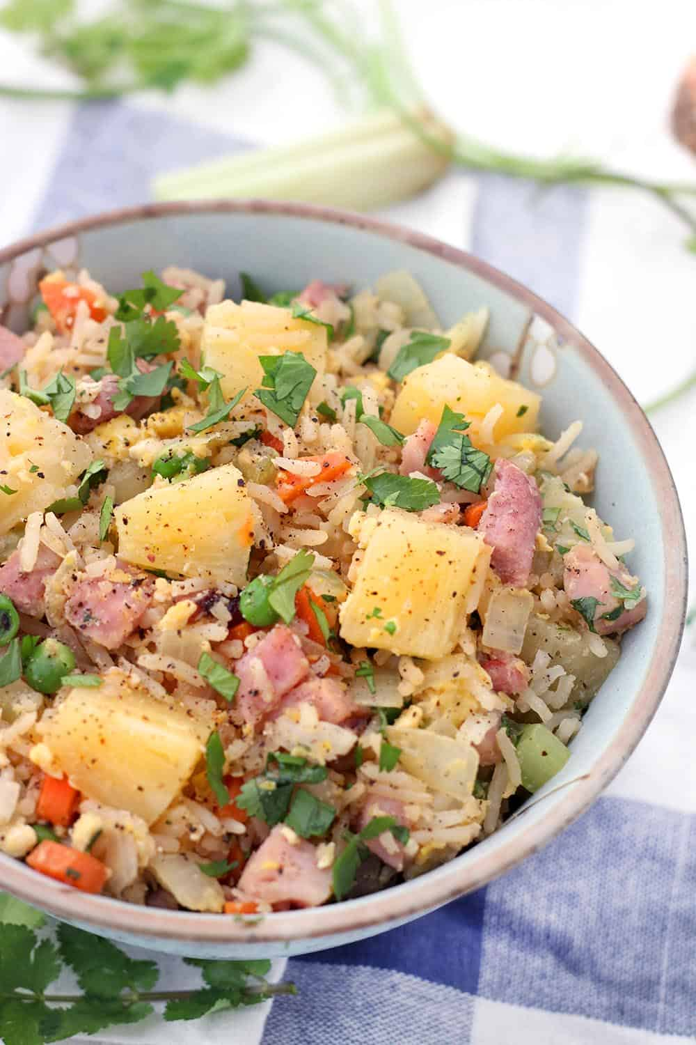 This Pineapple and Ham Fried Rice is a great recipe to use up leftover holiday ham! It only takes 15 minutes, one-pot, and it's easily made gluten-free. #FriedRice #LeftoverHamRecipes #Pineapple #QuickandEasy #15MinuteMeals #GlutenFree