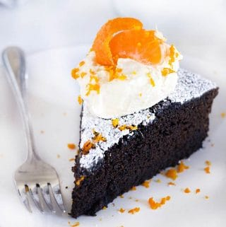 This spicy gingerbread cake with orange mascarpone cream is packed with fresh ginger flavor and all the holiday spices you love! It's not too sweet and has very little refined sugar, and pairs perfectly with the light, fluffy whipped cream made with mascarpone cheese and fresh orange zest and juice. It's the perfect holiday dessert! #Gingerbread #Oranges #WhippedCream #HolidayBaking #GingerbreadCake #LowSugar