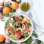 This delicious Winter Citrus Salad with Red Wine Vinaigrette is packed with seasonal Mandarin oranges and grapefruit. It's tossed with thinly sliced mushrooms, toasted almonds, and a versatile red wine vinaigrette, and is a great recipe for meal prepping!