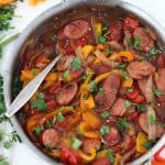 This one-pot Sweet and Spicy Sausage with Peppers and Onions is super easy to make with only four main ingredients, and delicious served over cooked rice or quinoa! It's sweetened with just a touch of honey and has a kick from crushed red pepper.