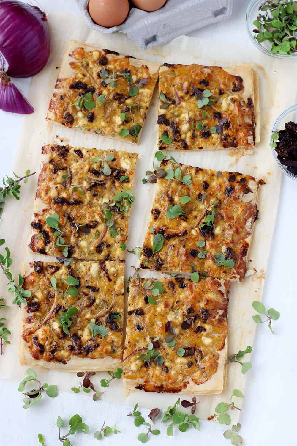 This Feta and Sun Dried Tomato Tart recipe is the perfect vegetarian appetizer or light meal. It's easy to make using filo(phyllo) dough, or even puff pastry.