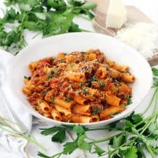 With a few tricks and only five ingredients, you can make the BEST Pasta with Bolognese sauce at home- the kind where the sauce clings to every piece of pasta and has the most authentic Italian taste!