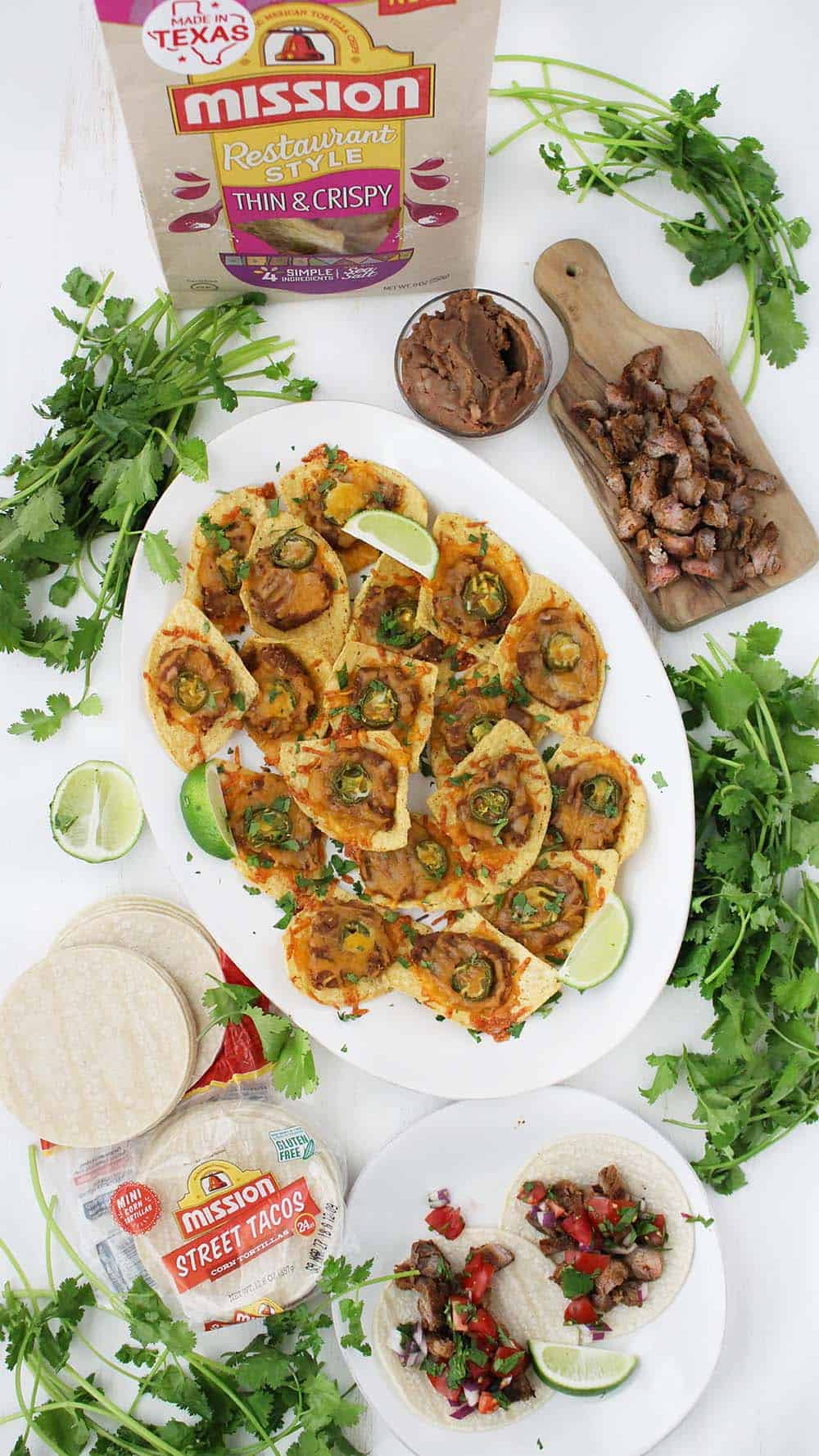 """These vegetarian """"Super"""" Nachos with Refried Beans, Cheese, and Jalapeños are each topped individually and baked. They're the perfect appetizer to make for company and take only 5 minutes of prep!"""