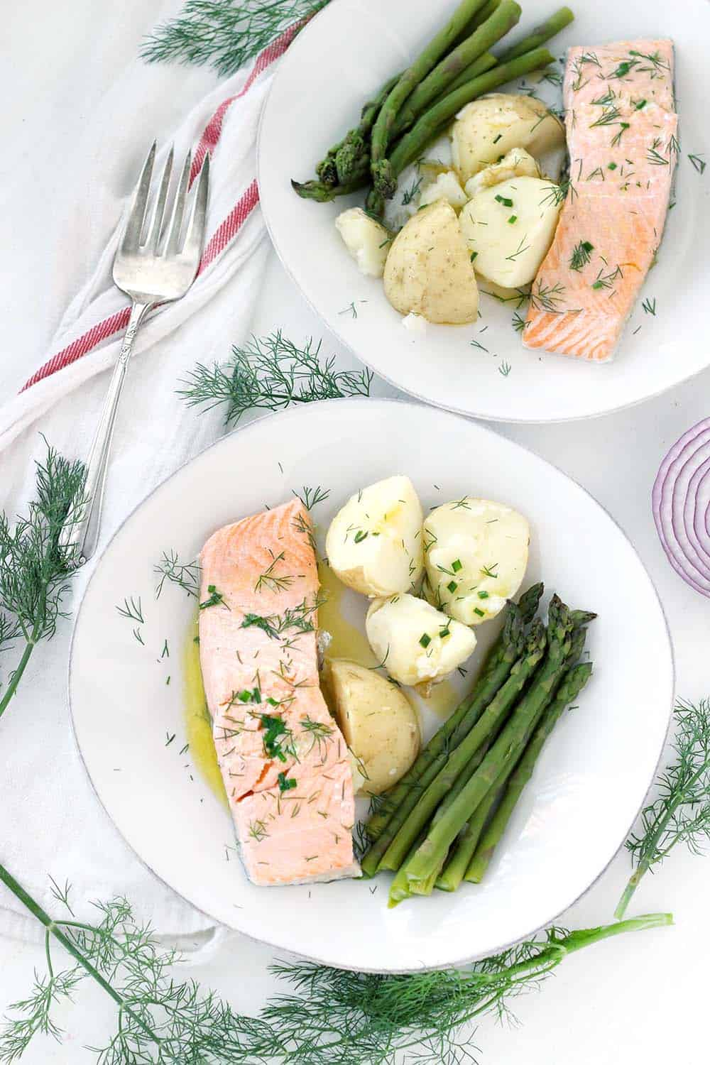 This poached salmon recipe comes out perfectly moist and flaky every time! It's drizzled in a delicious chive butter, takes only 15 minutes, and is a perfect low-carb, keto recipe.