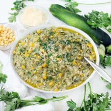 This vegetarian sweet corn and zucchini risotto recipe is such a great way to enjoy summertime vegetables! The zucchini is grated, so it melts into every bite while still maintaining a great texture, and the corn cobs are used to add flavor and starch to the broth base. The leftovers are great for brunch served with a fried egg on top.