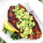 This super flavorful Blackened Tilapia comes together in less than 10 minutes!! Topped with a cool and refreshing avocado cucumber salsa, this is the perfect quick and easy low-carb recipe. Paleo, gluten free, and whole30 compliant.