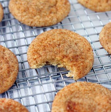 These Pumpkin Spice Snickerdoodles have warming pumpkin pie spices in the batter and are rolled in a mixture of brown and white sugars with cinnamon and more pumpkin pie spice! There's NO actual pumpkin used in this recipe. Make in bulk and keep in your freezer for a fun fall treat!