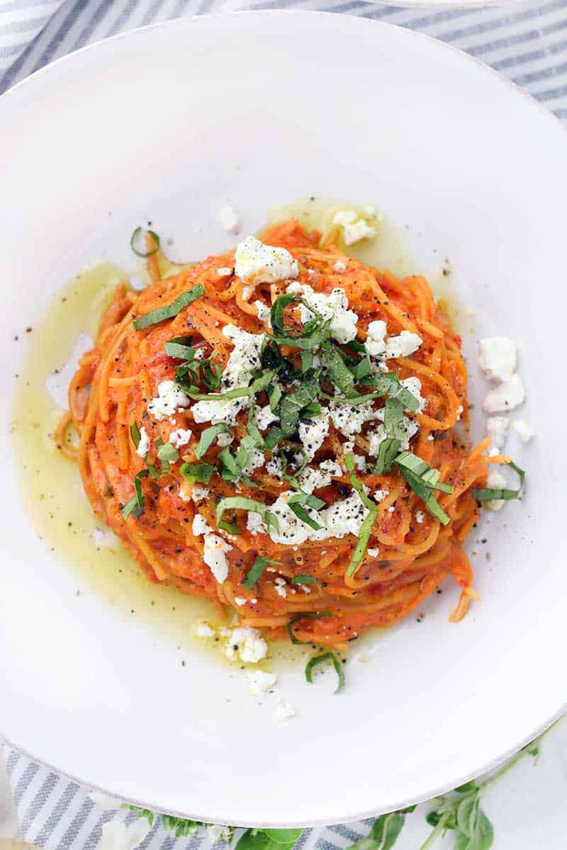 This vegetarian Spaghetti with Roasted Red Pepper Sauce and Goat Cheese recipe is an easy weeknight meal, and a great alternative to tomato-based sauces! It's naturally sweet, slightly spicy, and creamy from the goat cheese.