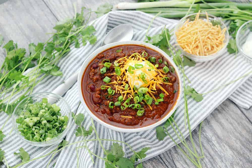 Instant Pot Pumpkin Chili is so easy to make and packed with fall flavors from pumpkin pie spices and apple cider! This recipe uses a whole can of pumpkin and is slightly sweet, slightly spicy, and tastes smooth and velvety.