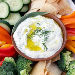This Authentic Tzatziki Sauce (Greek Cucumber Yogurt Sauce) is SO easy to make! Use as a dip, as a spread on sandwiches or gyros, or mix into chicken or tuna salad.