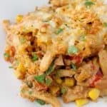 Close up photo of Tex Mex tuna noodle casserole on a white plate.