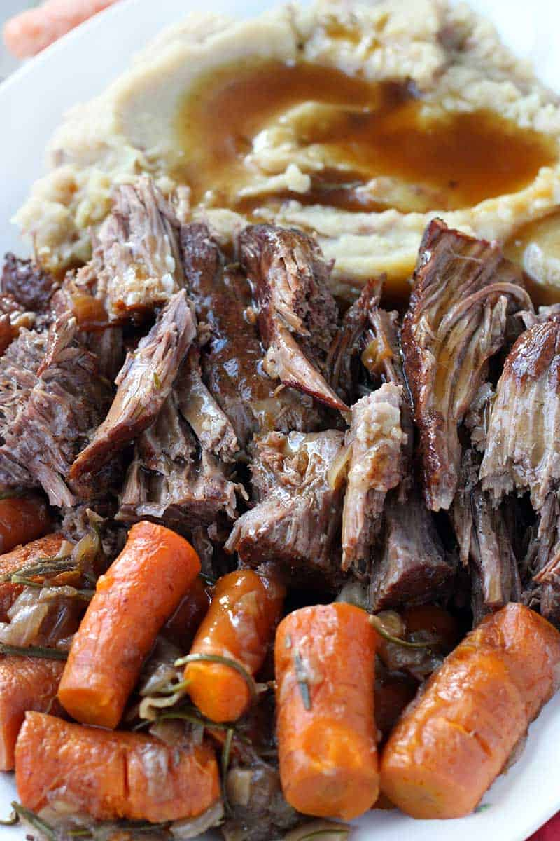 Instant Pot Pot roast, mashed potatoes, carrots, and gravy close up photo
