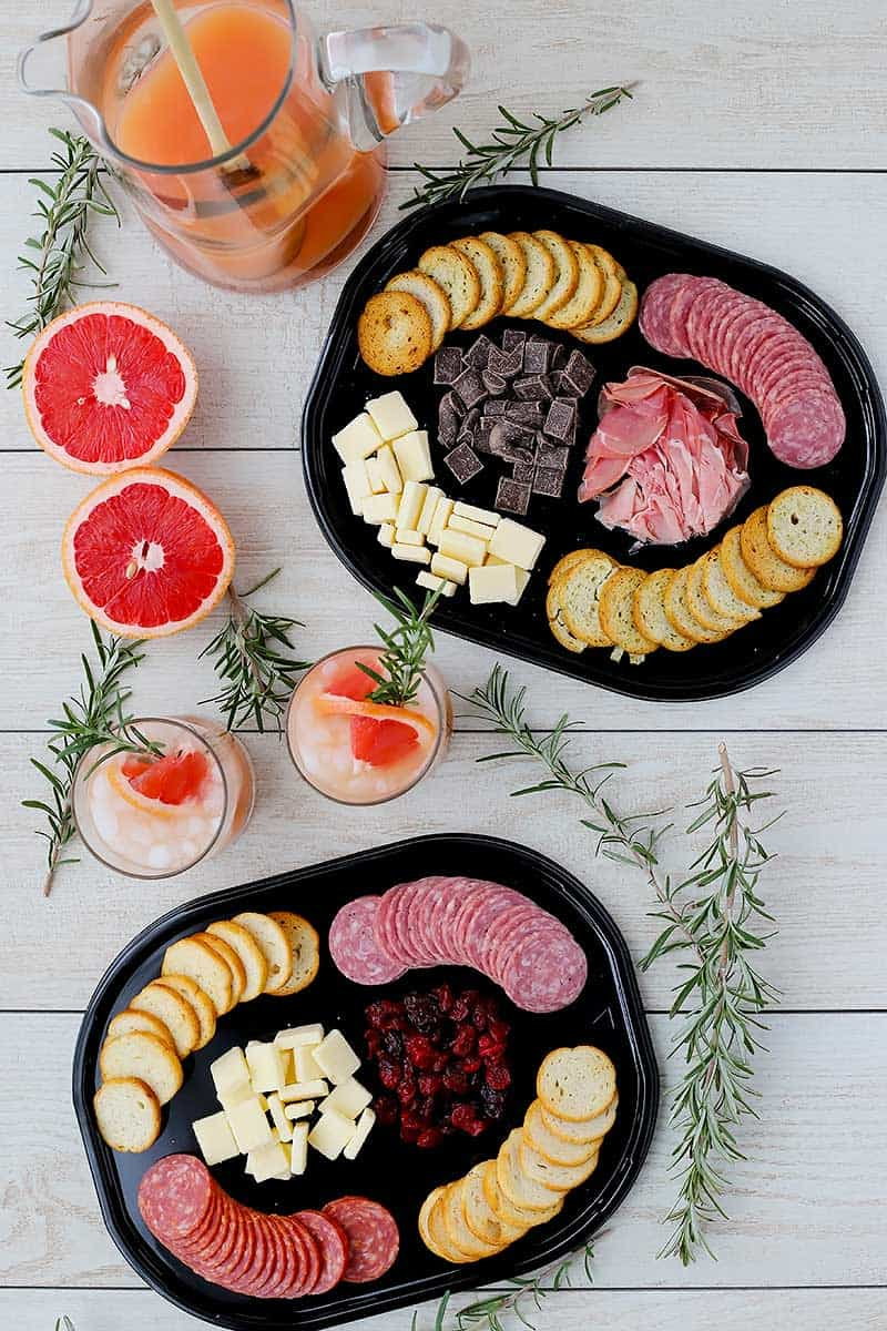Overhead photo of hillshire snacking platters and cocktails.