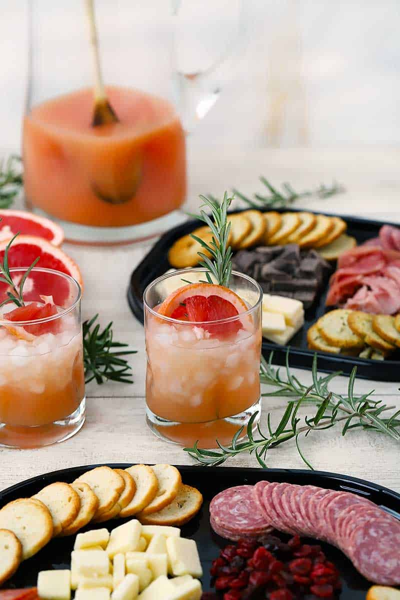 Grapefruit rosemary greyhound cocktails with charcuterie platters.