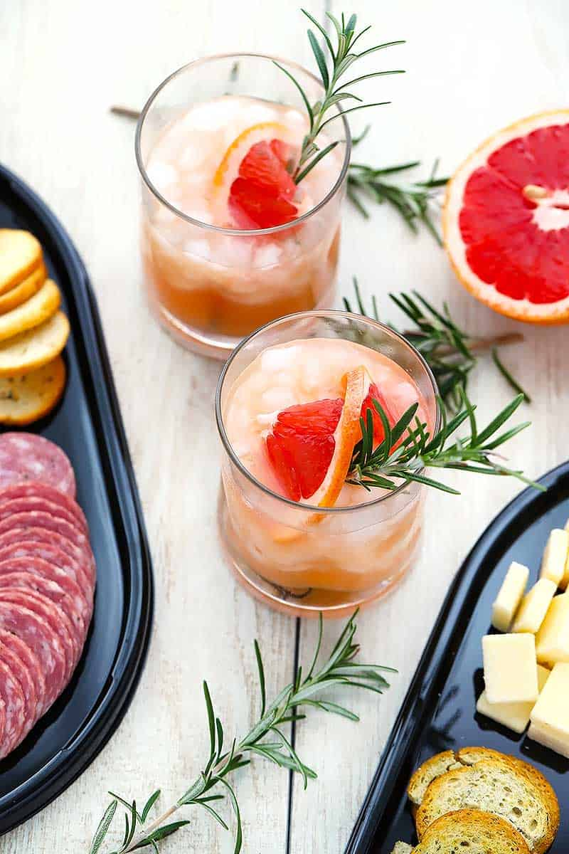 These Rosemary Greyhound Cocktails are made in batch, so they're easy to mix in advance for a party. This recipe uses grapefruit juice, vodka, and rosemary simple syrup- you can use seltzer for a virgin alternative.