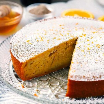 This Orange Olive Oil Cake is scented with cardamom and cinnamon is super moist and baked with yogurt and honey, with no refined sugar.