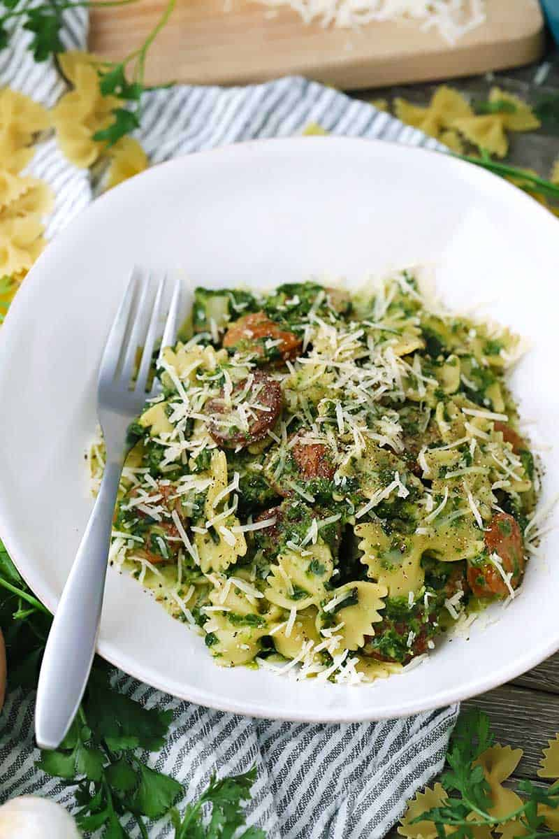 This Creamy One-Pot Pasta with Sausage recipe is packed with a whole pound of spinach and only takes 30 minutes to make. It's covered in a creamy, luxurious sauce that clings to every bite.
