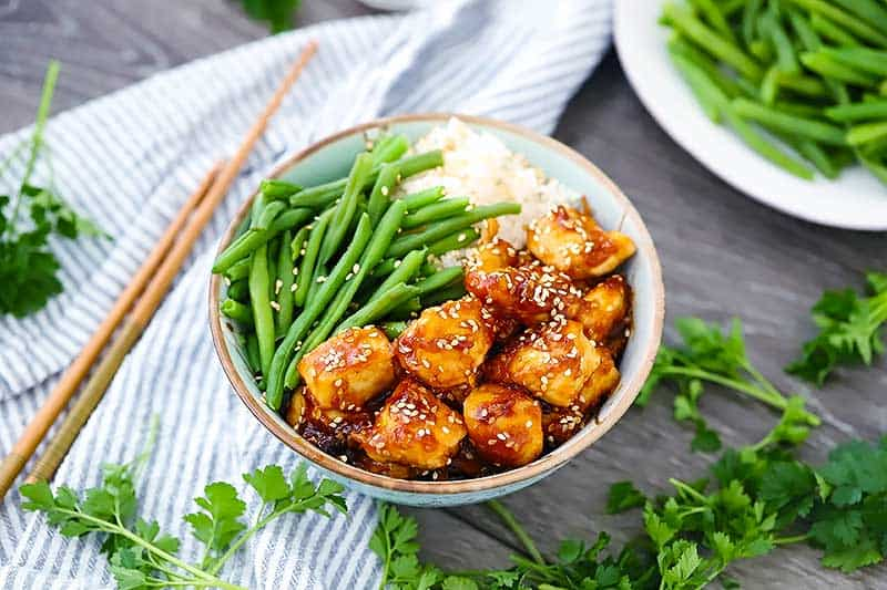 This 20-Minute Sesame Chicken is easy to make with no deep frying required! It's perfect for a weeknight dinner served with steamed rice and green beans.