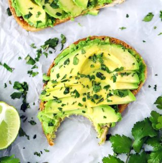 This vegan Avocado Toast recipe is simplicity at its best. Mashed AND sliced avocado, a drizzle of olive oil and a rub of garlic, with a generous sprinkling of salt and squeeze of lime make for the PERFECT avocado toast every time!
