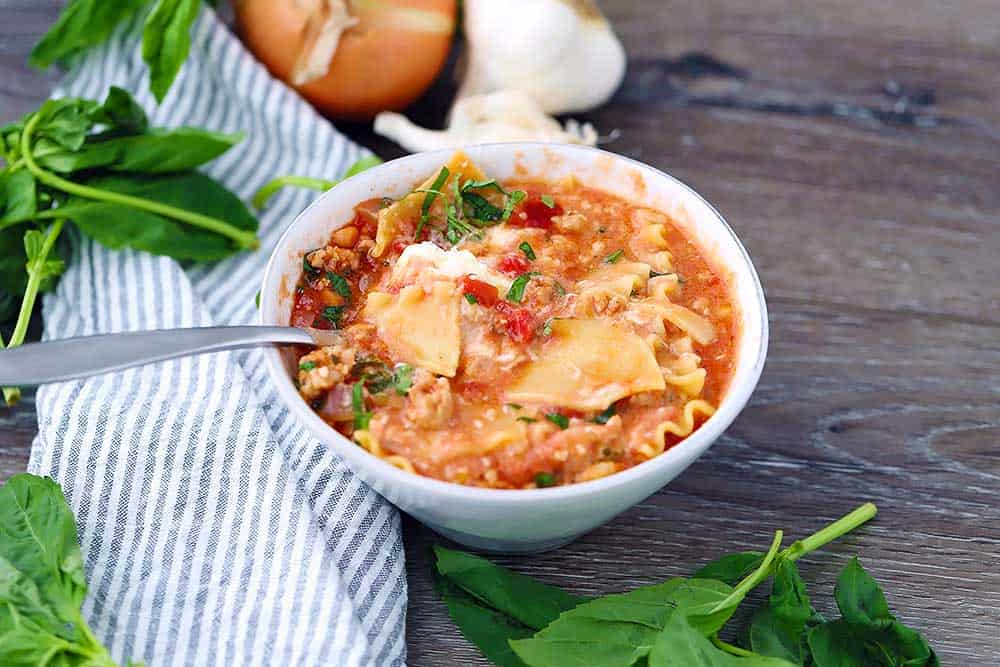 Horizontal photo of a bowl of lasagna soup.