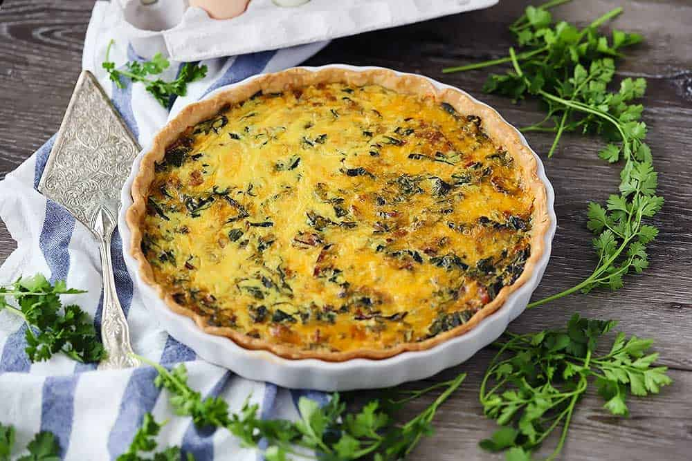 Horizontal photo of a cooked quiche.