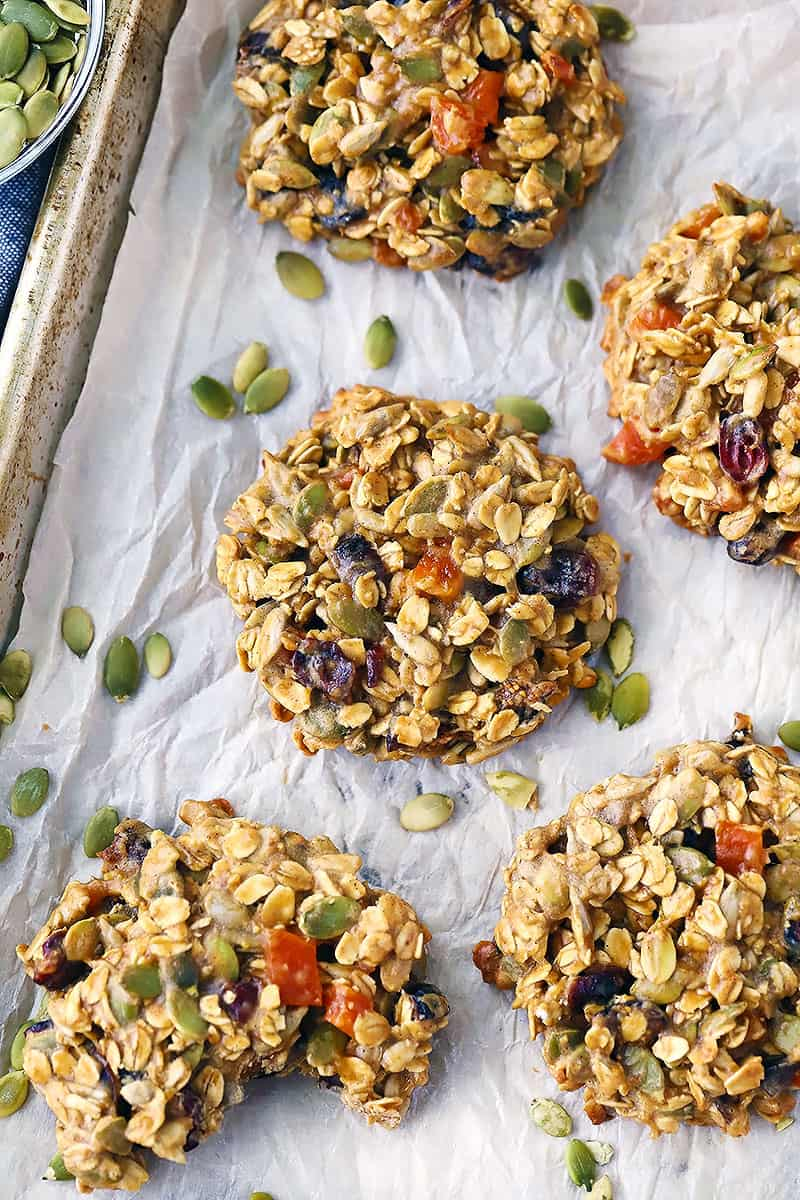 Overhead photo of breakfast cookies with pumpkin seeds scattered around.
