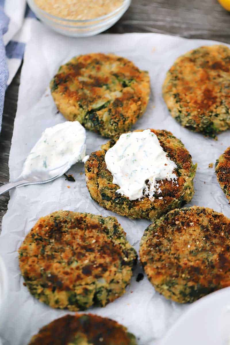 These vegetarian Spinach and White Bean Patties are a simple and delicious veggie burger served with a cool, creamy dill yogurt sauce.