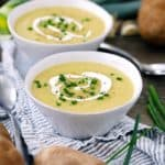 This simple Irish Potato Leek Soup has only FOUR ingredients and comes together in only 30 minutes! There's no milk or cream in this recipe- just leeks, potatoes, stock, and plenty of butter.