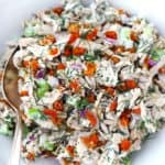 Apricot Dill Chicken Salad with Sunflower Seeds in a bowl with a spoon.