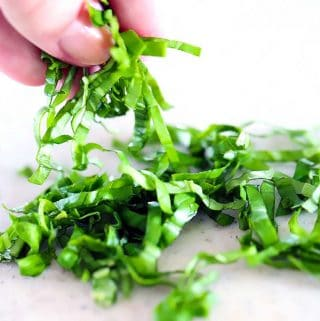 A finished chiffonade of basil for garnish or cooking
