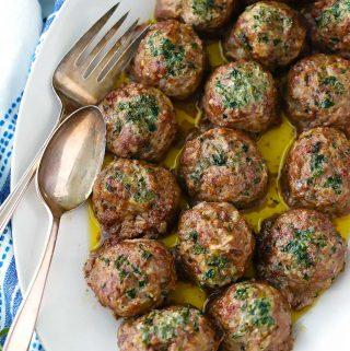 A close up photo of greek meatballs