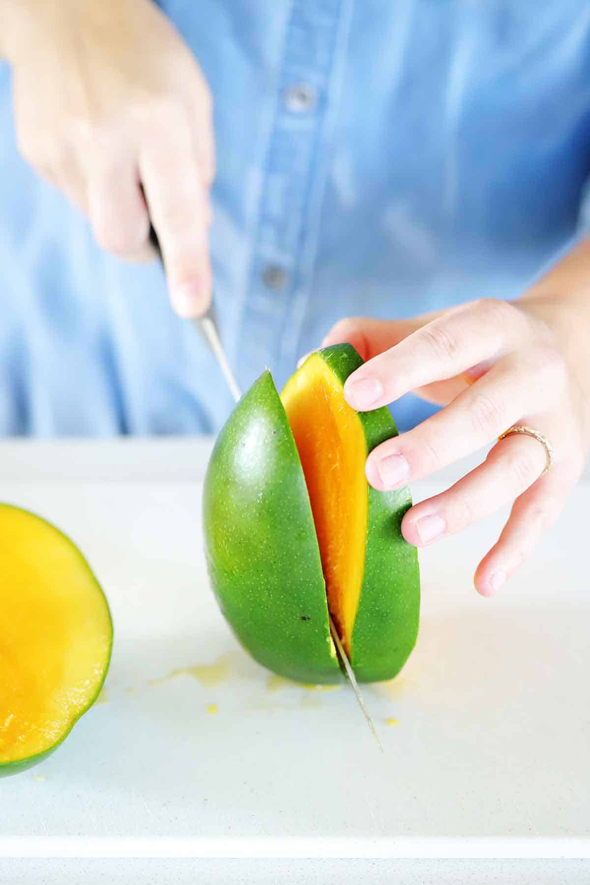 Slicing the sides off a mango