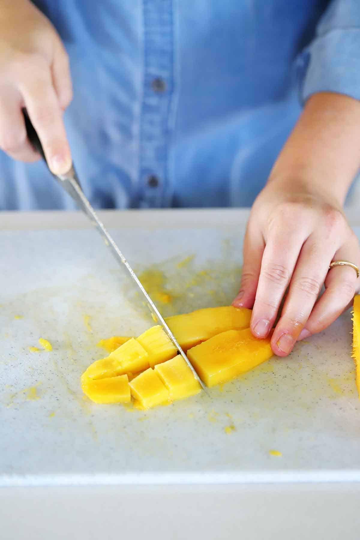 Slicing thin strips of mango.