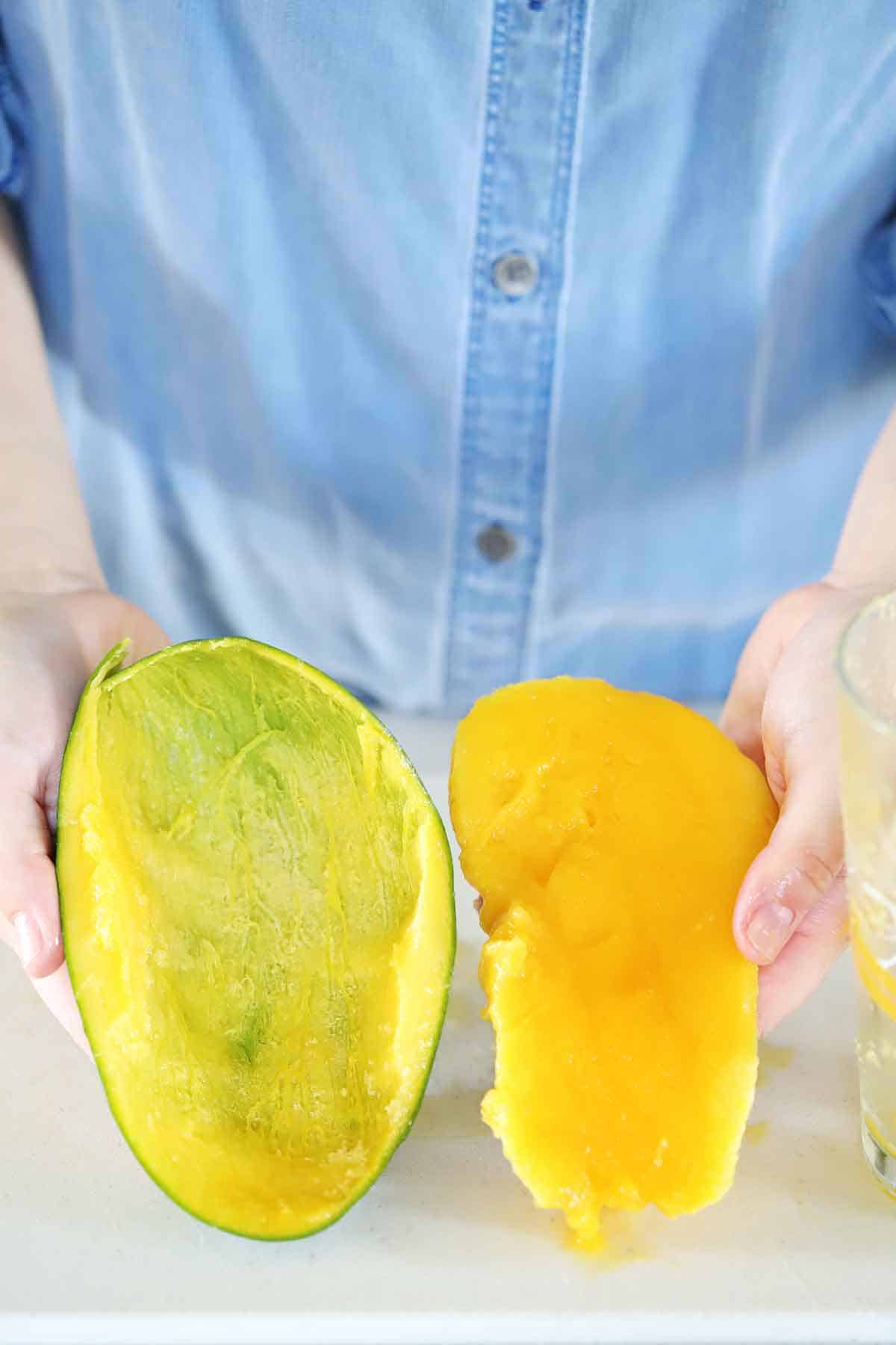 A mango separated from its peel.