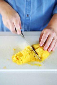 Cutting mango into cubes.
