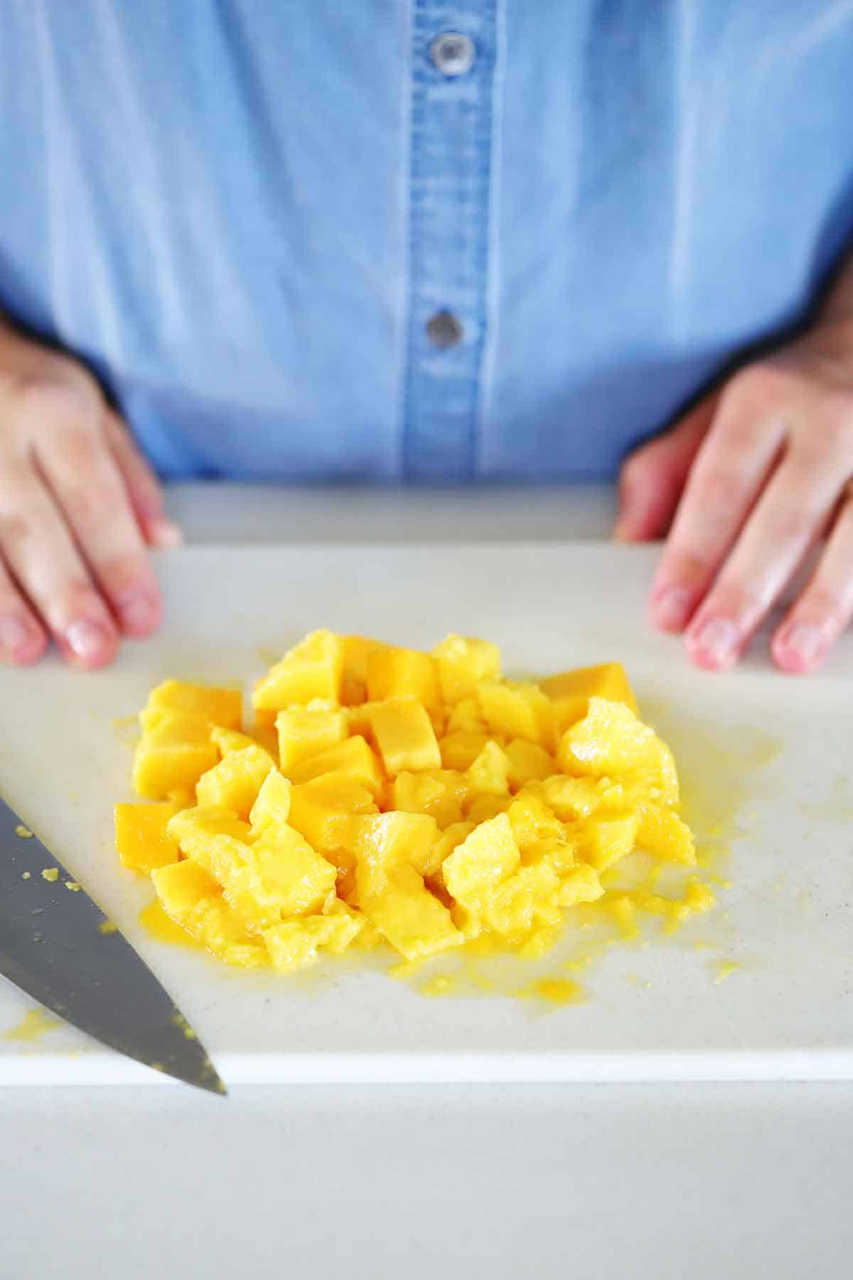 Chopped mango on a cutting board.