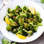 Roasted Broccoli with Garlic and Lemon on a white plate.