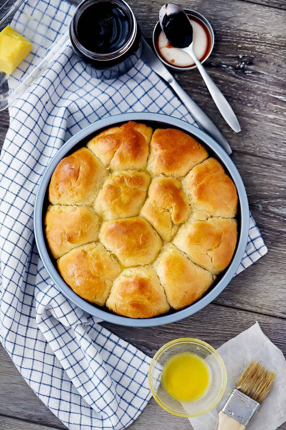 Overhead photo of quick and easy pull-apart dinner rolls in a round pan.