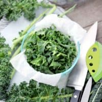 Prepped kale in a container square image.