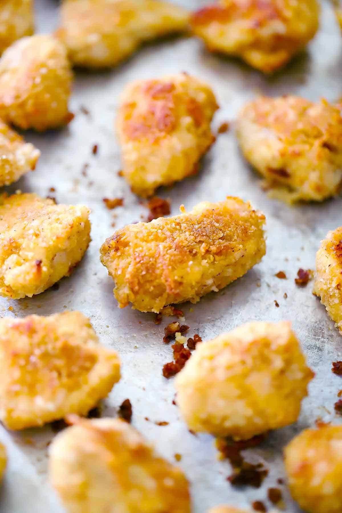 Chicken nuggets on a baking sheet.