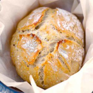 Square image of no knead dutch oven artisan bread