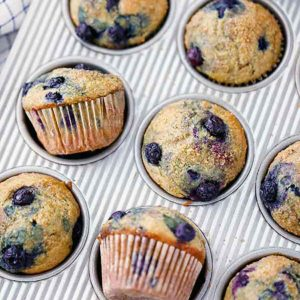 square photo of healthy blueberry muffins in a muffin pan.