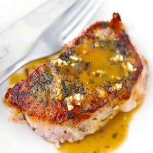Square photo of oven baked pork chops.
