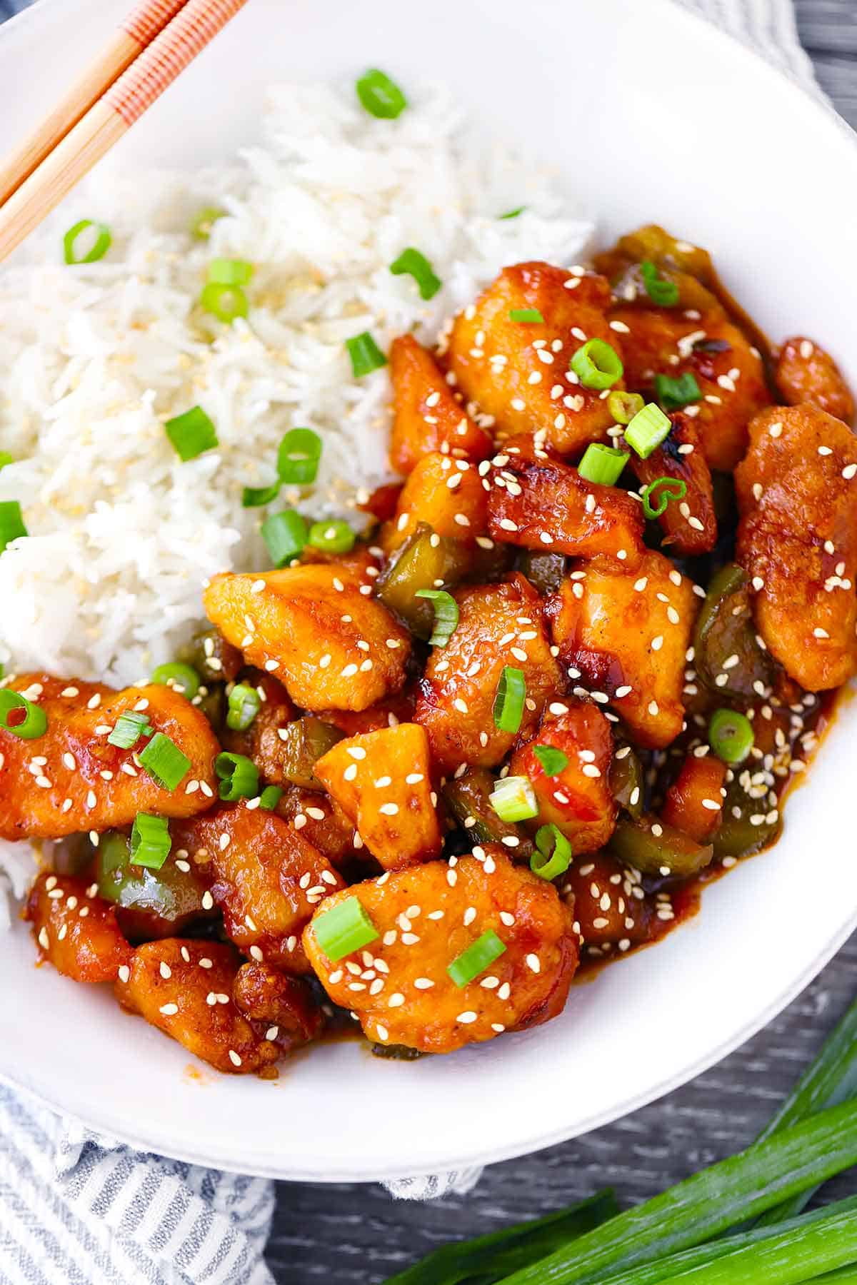Close up photo of sweet and sour chicken with pineapple.