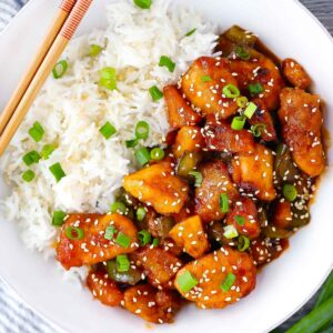 Square photo of sweet and sour chicken with rice.